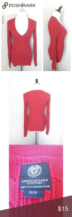 """{american eagle} bodycon sweater An eye-catching hot pink form fitting deep v cable sweater.   Brand is American Eagle Outfitters.  Sexy yet sweet. Pair with a lacy camisole, jeans and ballet flats for a girly and chic look.  Gently worn. Size small.  Modeled on my mannequin:  measurements are 35"""" chest 26"""" waist and 34"""" hips American Eagle Outfitters Sweaters"""