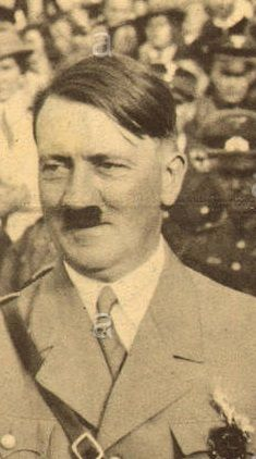 Hitler wearing a black mourning flower? See breast pocket, 1933. Not sure what that is. (via putschgirl)