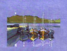 Little fishing boats by a harbour wall in the evening.