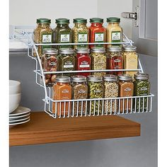 Every chef will appreciate the convenience of our three-tier, vinyl-coated wire spice rack.  The clever design allows you to pull it down and display spice jars and tins at eye level.  The sideguards and tightly-spaced wire construction keep containers from falling out.  The rack mounts easily on the inside of an upper cabinet.