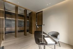 The en-suite bathroom is elegantly concealed behind wooden panels
