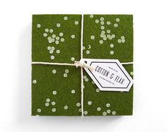 Made from richly hued forest green designer wool felt, these thick, hand-printed coasters will keep your furniture safe from hot or cold beverages.   This confetti pattern is a Cotton & Flax original design, and adds a festive touch to an everyday happy hour. The forest green color of the felt makes for perfect holiday decor.  Each coaster is silkscreen printed by hand using eco-friendly, non-toxic ink.   • Set of four • 100% Merino Wool felt • Each coaster measures 4 x 4 inches, 3mm thick •…