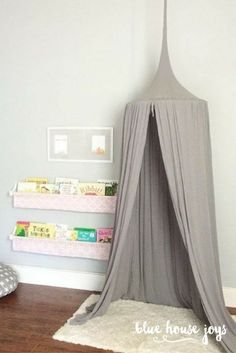 A fun and whimsical gray play tent for your child to climb into and dream about their next adventure. Perfect for playrooms, nurseries, and kids spaces. Visit our shop at bluehousejoys.com/shop/ for more inspiration!