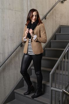 Camel blazer with black and white stripes and faux leather leggings outfit
