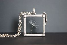 What?? This is awesome  =)  Dandelion Necklace. Dandelion Locket Necklace.. $26.00, via Etsy.