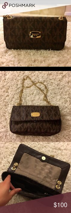 Michael Kors Shoulder Bag/Clutch This is an adorable bag/clutch.  The fabric of the bag is in excellent condition.  There are scratches on the logo metal - see pic #4. Michael Kors Bags Shoulder Bags