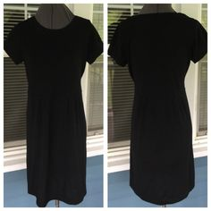 "BANANA REPUBLIC BLack Merino Wool Dress A classic!  Wear with bootsBANANA REPUBLIC BLack Merino Wool Dress.  Short sleeves.  Black extra fine Italian merino wool fiber knit.  Soft!  Shoulder width 14"". Pit-to-pit 18"".  Length 36"" (shoulder to hem).   Excellent condition. Banana Republic Dresses Midi"