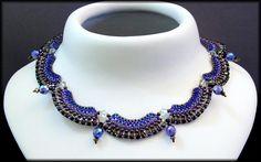Kronleuchterjuwelen Glasperlenschmuck - blaues Bogencollier