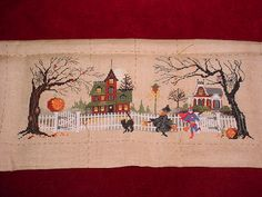 This is not my finish I did mine on grey fabric as the kids where I live start to trick or treat when it starts to get dark.