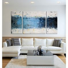 Add a modern and artistic flair to your bedroom, living room or office with this three-piece gallery-wrapped canvas art set. Its primarily blue and white desi…