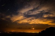 Hosted by imgur.com ~ A meteor shower in the night sky over Denver, Colorado.
