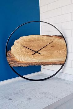 This gorgeous large wall clock is made of oak wood and is perfect for rustic decor. #woodwallclock #liveedgewoodslab #clocksforwall #farmhousewallclock #farmhousewalldecor #kitchenwallclock #decorativeclock #farmhouseclock #hangingclock #kitchenclock #largewallclock #liveedgeclock #minimalistclock #modernwallclock #modernwoodclock #naturalwoodclock #farmhousedesign #farmhousestyle #farmhouselivingroomdesign #rusticwallclock #rusticwoodclock #silentwallclock #uniquewallclock #woodenclock #loft Large Rustic Wall Clock, Unique Wall Clocks, Wood Clocks, Farmhouse Wall Decor, Rustic Decor, Minimalist Clocks, Hanging Clock, Kitchen Wall Clocks, Country House Interior