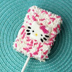 what a cute party favor for a little girls bday..Hello Kitty rice crispie squares...