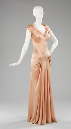 """Evening Dress, Charles James (American, born Great Britain, 1906–1978): 1945, American, silk. """"Charles James produced some of the most memorable garments ever made. He began his design career in the 1930s. It peaked between the late 1940s and mid- 1950s, when his scarce and highly original gowns were sought after by society's most prominent women. Personally draping and constructing the garments that bear his label, he is considered to be the only American to work in the true couture…"""