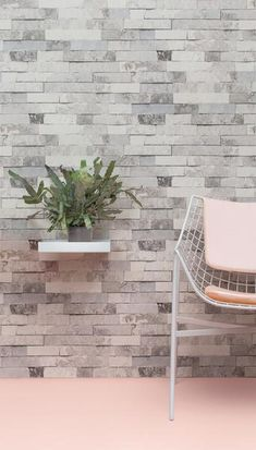 A stone slab wall effect wallpaper design which creates a stunning feature wall.