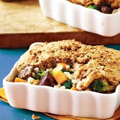 Craving comfort food without the guilt? Dig into these nutrient and fiber-packed individual-sized beef and barley pot pies slathered in pillowy biscuits.