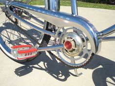Close-up of Sears Spaceliner regular tank bike chainguard, hub cap & red Wald jeweled pedals. Thinking about picking up a set of these pedals for my chrome Spaceliner.