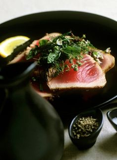 "Miso Glazed Seared Tuna with Fresh Herb Salad. You've probably seen a version of this recipe on upscale restaurant menus, but it's easy to make at home if you buy ""sushi quality"" tuna from your fishmonger. Tuna Recipes, Seafood Recipes, Healthy Dinner Recipes, Cooking Recipes, Salad Recipes, Quick Recipes, Tuna Salad, Seared Tuna, Recipes"