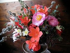 Pussy willows, daffodils, berries, red and white lillies, peonies and are those Scarborough lilies?! I love those and haven't seen them in a long time. They have a beautiful clear scarlet color.