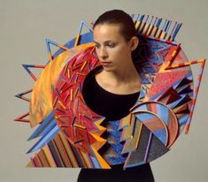 """Marjorie Schick neckpiece 1988, """"there are four major aspects to my work: the constructed, three-dimensional form; the color relationships; the definition of space; and the scale of the objects in relationship to the human figure."""" Her principle goal, she states, is to create a """"visual tension"""" among the formal elements of her bright, skeletal constructions."""""""