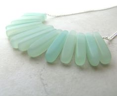 Seaglass Sea Glass Necklace Seafoam Mint Green Wire Wrapped Tusk Necklace BellinaCreations Bellina Creation. $36.00, via Etsy.