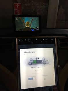 Nintendo Switch is a great way to pass the time in a Tesla #Tesla #Models #car #Automotive #cars #Autos