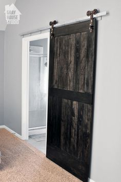 Creating a Wood Barn Door - One weekend we took off the chunky half french doors with gold doorknobs to the master bathroom and replaced it with a large, custom…