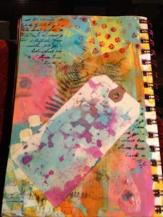 Colorful art journal background with acrylic paint, stencils and stamps, by Claire.