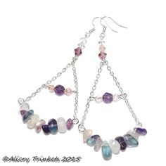 "Fluorite Hammock earrings.    These beauties are fluorite and crystal and hang at the length of over 3½"" (90mm) The fluorite hammock is 40mm but curved so maybe a little wide if it were straight.  Fluorite promotes spiritual and psychic wholeness and development, protection, and brings peace.  It helps one meditate and learn to go past the ""chatter"" that our minds tend to generate when first learning to meditate. It is said to reduce or eliminate negative energy."