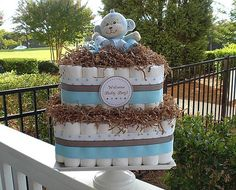 Square Diaper Cake: Break away from the standard circle cake and offer the proud parents-to-be a square cake ($79) to adorn their nursery.