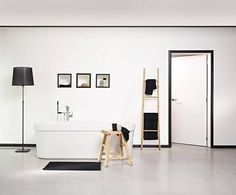 Creating unity and creating a modern look? Just use multifunctional skirting boards that contrast with the floor and wall and let them continue around the door. Trendy effect guaranteed! Black Interior Design, Black Interior Doors, Black And White Interior, Black White Bedrooms, White Walls, Metal Daybed, Orac Decor, Dado Rail, Black And White Theme