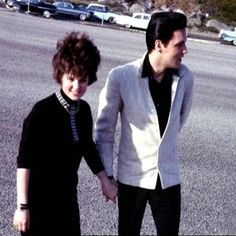 After Elvis' repeated pleas to Priscilla's father, She flew to Santa Monica, California in 1962.  (Elvis was finishing a film at that time). He had asked her to spend the Christmas Holidays with him at Graceland. It was the first time they had seen one another since He left Germany in 1960.