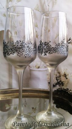Set of 2 hand painted toasting champagne flutes with very delicate silver lace with clovers and small hearts around the glass and silver