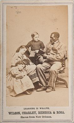 1864 cdv of black slave, Wilson Chinn reading to 3 fair-skinned New Orleans slave children. Proceeds of the sale of cdv was used to raise money for education of Colored People in the Gulf. Northern whites were shocked and outraged at sight of white slaves (the light-complexioned slave children in this and other cdv's were described as immoral offspring of slave-owners).  *s*