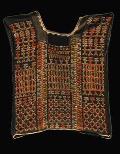 Africa | Wodabe Blouse.This blouse is embroidered on stitched-together strips of indigenous Wodabe indigo-dyed cotton, plus two strips of striped Hausa trade cloth. All embroidery, stitching, and weaving is by hand with the exception of the ticking on the collar and hem, which are imported bleached material. Wodabe looms were traditionally very narrow, producing gauzy strips about 3 cm wide. | Collected by Boubacar Doubou in the late 1980s. It dates from the 1970s or before.