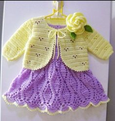 Crocheted baby dress and sweater.