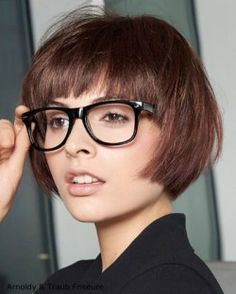 Brunette bob haircut with bangs paired with glasses. #BobCutHairstylesWithBangs