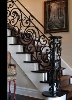 not crazy about the hand rail itself or the curve at the end...they feel too new, but the scroll work in the middle section is beautiful for the flow of staircase.