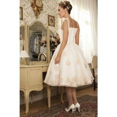 The New Orleans: Lush satin and organza gown is adorned with large polka dots, which are placed on both the outer layer of organza and on billowy tulle beneath, giving this dress fantastic dimension.
