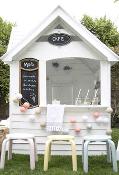 How adorable is this revamped playhouse. A wooden playhouse turned in to a café. It would also work well with a more grown up feel, say a cocktail. Great for stylish outdoor living.