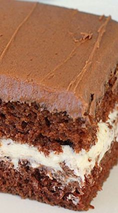 Chocolate Cream-Filled Cake - this cake tastes like a Little Debbie Swiss Cake Roll! Chocolate cake with vanilla cream filling and chocolate buttercream. Cupcake Recipes, Baking Recipes, Cupcake Cakes, Dessert Recipes, Just Desserts, Delicious Desserts, Brownie Cake, Brownies, Chocolate Desserts