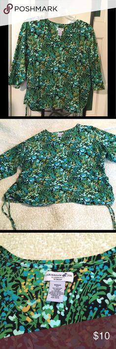 Caribbean Joe Woman's Top Various shades of blues and yellow flowers on a black background. 95% cotton /5% spandex.  Very comfortable.  Like new. Only worn twice. caribbean joe Tops