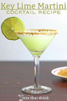 The Key Lime Martini drink recipe blends vanilla vodka with the flavors of key lime and coconut. The graham cracker crumb rim makes it taste like key lime pie. This is a wonderful drink for parties! #drinkrecipe #keylime #martini #cocktailrecipes