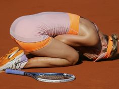 Maria Sharapova collapses with joy after winning the French Open title against Simona Halep.