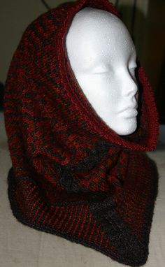 """Less than a week left until the release of the first installment of The Hobbit! If you wear the Balrog Cowl you have free reign to shout """"None shall pass!"""" at anyone who tries to take the seats you're saving for your friends. We think it would look fabulous in the Rata and Kokako colors of Mythral (http://theyarnsisters.shptron.com/p/mythral).    Ravelry pattern link: http://www.ravelry.com/patterns/library/balrog-cowl-hood"""
