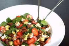 Ingredients 4 cups baby spinach 5 strawberries, sliced ¼ large Haas avocado, pit and skin removed and sliced 3 tbsp crumbled goat cheese ½ cup pecans 1 tbsp + 2 tsp maple syrup 1 ½ tbsp olive oil 1 ½ tbsp balsamic vinegar 2 pinches Celtic sea salt and pepper