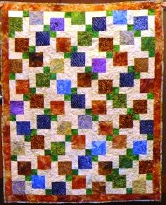Beautiful jewel tones in this Disappearing Nine Patch quilt.