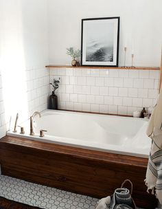 Cedar planks, stained a deep brown, create a luxe front as well as a shallow ledge for perching on while getting in and out of the tub.