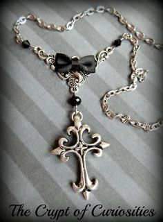 Gothic black and silver cross necklace. https://www.etsy.com/shop/TheCryptOfCuriositie