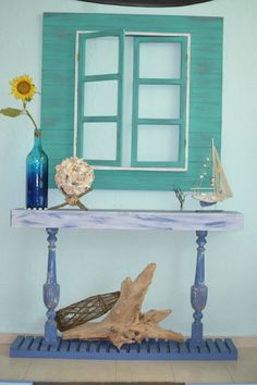 credenza and fake window beachy vintage style. Rustic simple decor. Beach house.  Nautical style. Coastal living. Vintage apartment.  Driftwood, orb, bottle, shipwreck